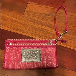 Pink Coach brand poppy wristlet